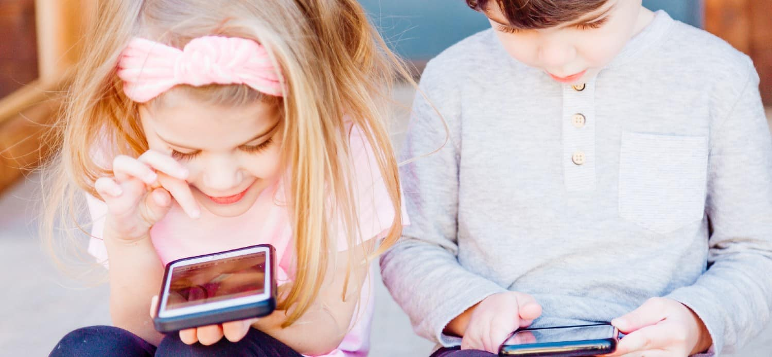 children using their mobile devices, phone and tablet